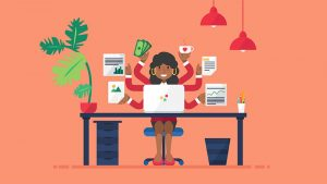 vector of woman sitting at a desk with multiple task icons around her representing the need for manager leadership training