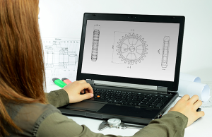 CAD design and management services represented by woman on laptop displaying a cad drawing